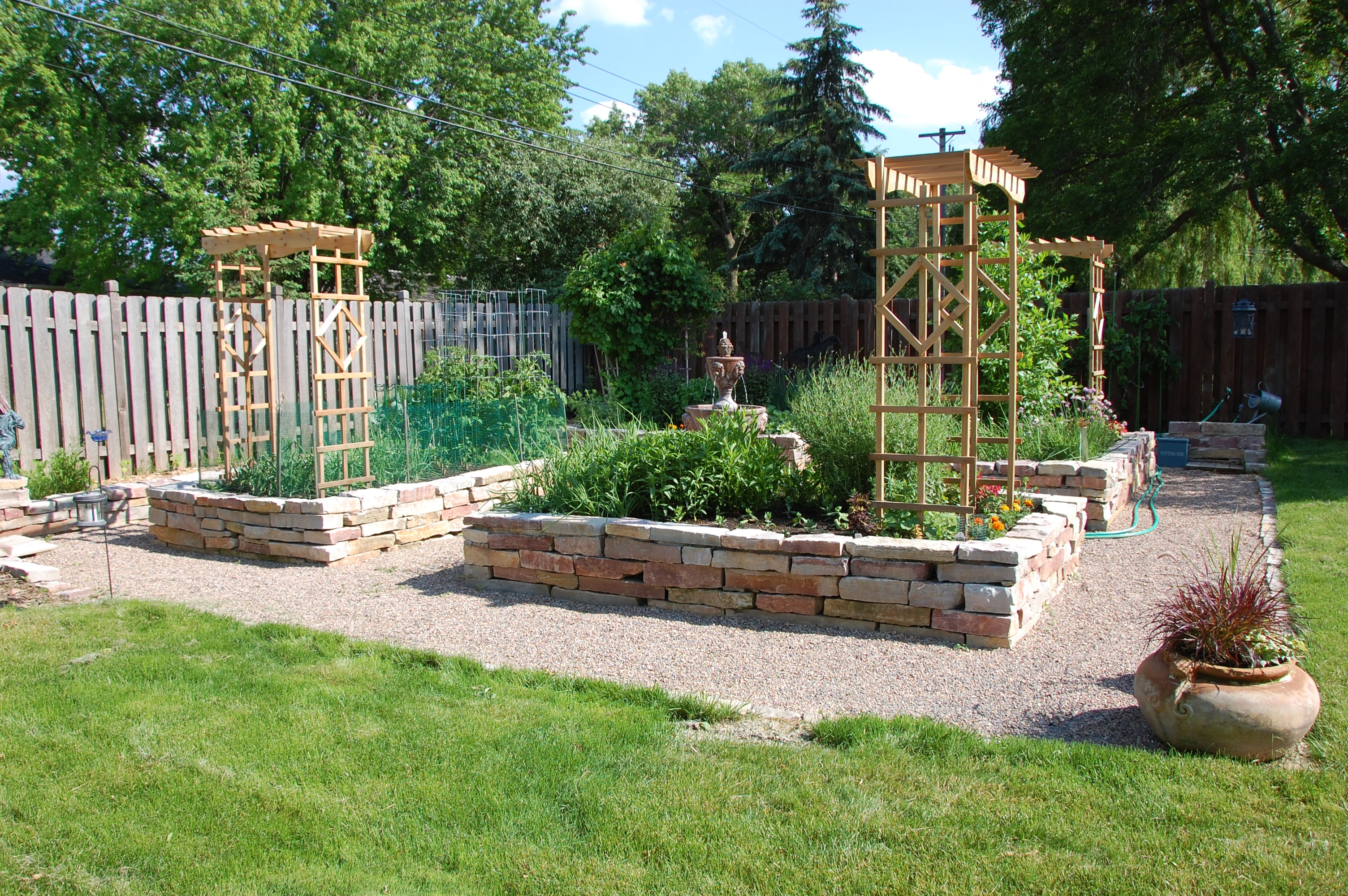 A garden saves your grocery bill i 39 m no june cleaver for Garden designs with raised beds